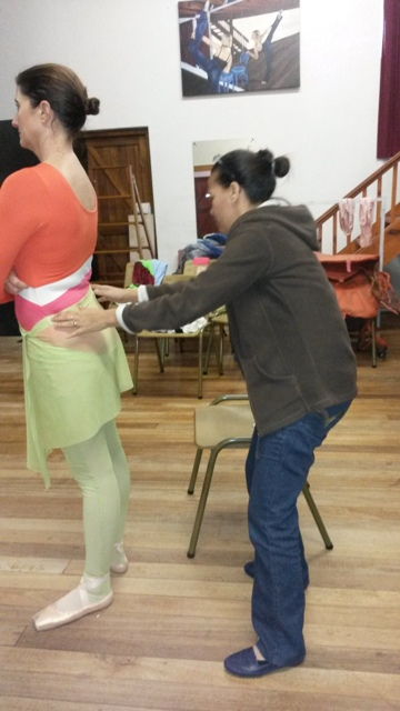 A patient Stratitzia and the dressmake in the final fit